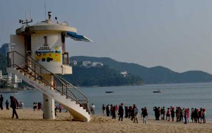 Lifeguard Tower at Repulse Bay, Hong Kong and tourists taking beach photos