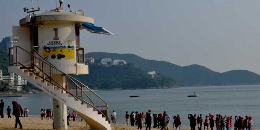 Lifeguard Tower at Repulse Bay, Hong Kong and tourists taking beach photos