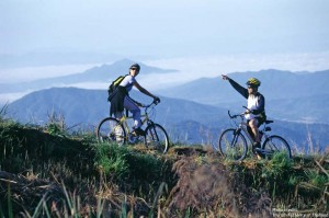 Two mountain-bikers in a beautiful rural mountain setting
