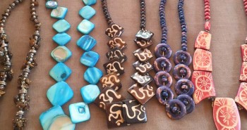 Homemade necklaces in various colors sold by a beach seller