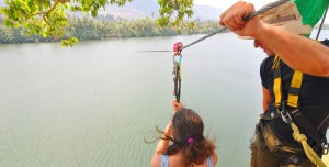 Woman ziplining in Cambodia