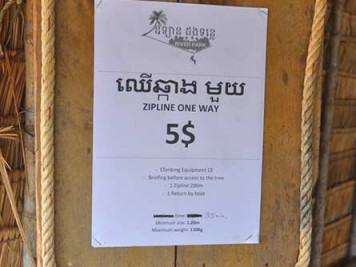 Zipline 5 USD sign, Kampot