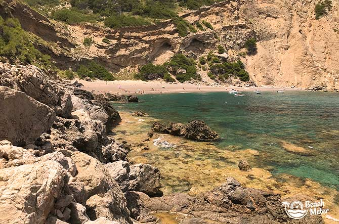 Rocky trail to Mallorca beach Playa Coll Baix